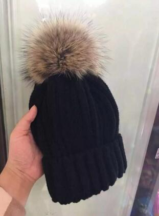 New winter raccoon ball wool cap lady tide raccoon fur knitted hat outdoor warm hat