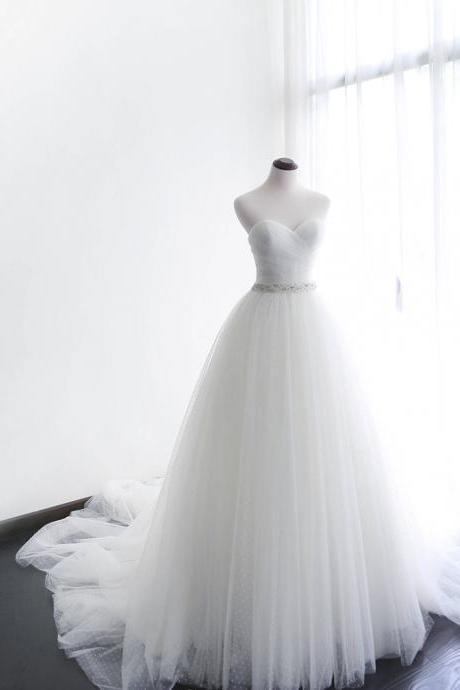 Strapless Sweetheart Ruched Beaded Tulle Ball Gown Wedding Gown Featuring Long Chapel Train