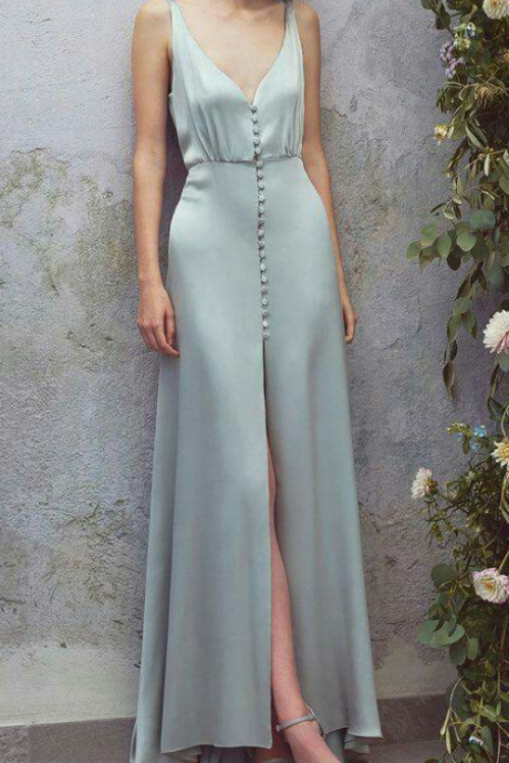 Attractive v-neck, grey sleeveless evening dress, elegant ball gown and cross-skirt.